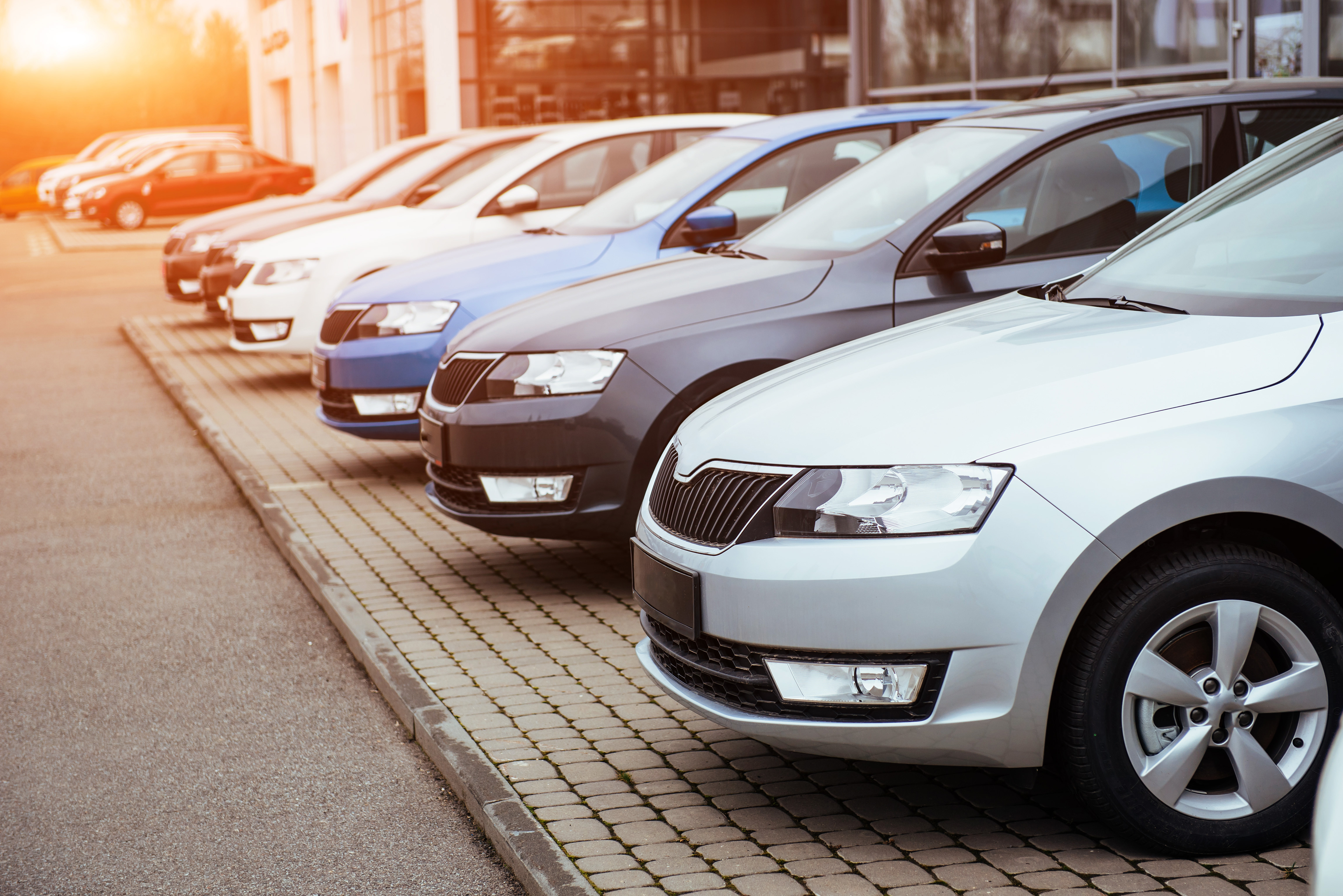 AdobeStock_137250472_row of cars